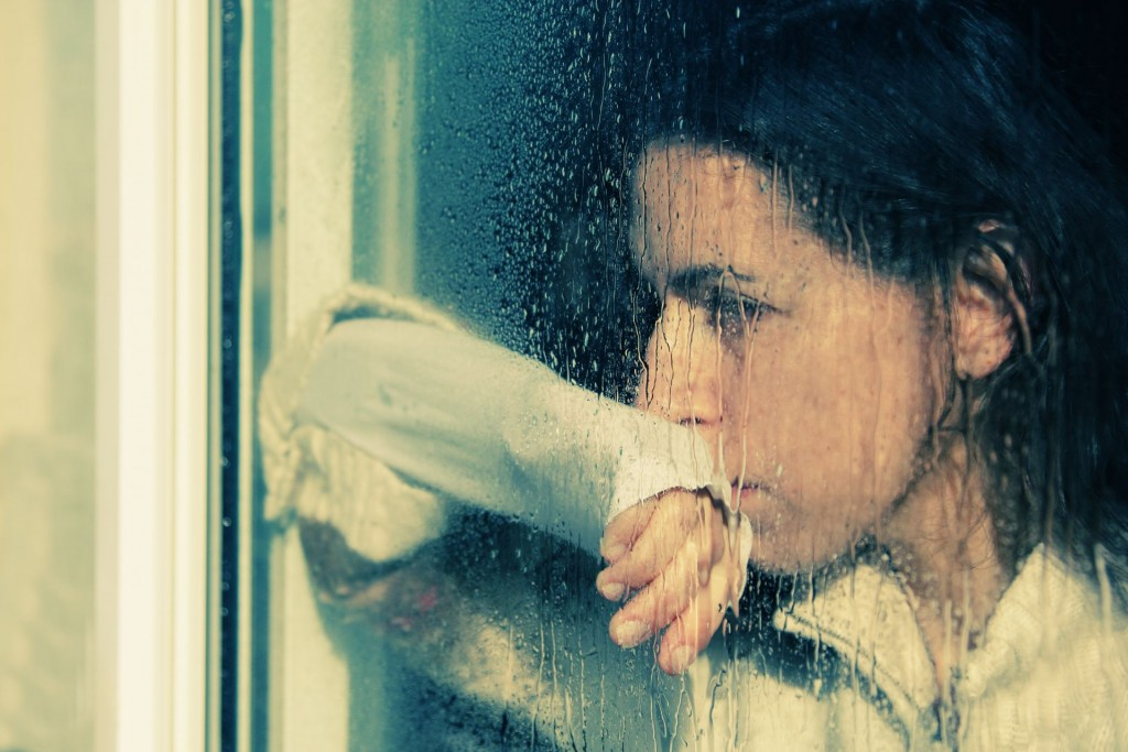 Just another depressed lady, staring out a window on a rainy day.